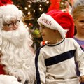 James Hamilton, 4, of Bentonville visits Saturday with Santa during the annual Breakfast with Santa ...