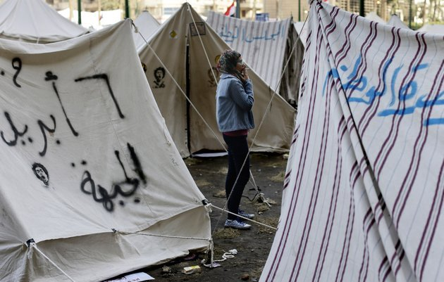 an-egyptian-protester-smokes-a-cigarette-outside-her-tent-in-tahrir-square-in-cairo-egypt-sunday-dec-9-2012-egypts-liberal-opposition-has-called-for-more-protests-on-sunday-after-the-president-made-concessions-overnight-that-fell-short-of-their-demands-to-rescind-a-draft-constitution-going-to-a-referendum-on-dec-15