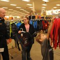 Cpl. Stan Cain with the Rogers Police Department shops Saturday at Pinnacle Hills Promenade with Sha...