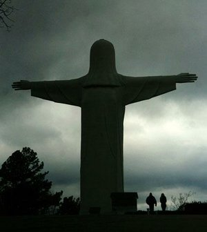 Rain clouds roll past the Christ of the Ozarks statue in this ÿ le photo from Dec. 23, 2009, at the Great Passion Play grounds in Eureka Springs.