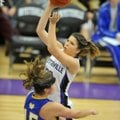 Sydney Crockett of Fayetteville High drives to the hoop past Mountain Home defender Katie Kapler dur...