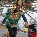 Leonardo Lopez from La Danza Azteca dances his way down North Whippoorwill Court in Fayetteville on ...