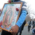 Ruben Alvarado Corona from St. Raphael Catholic Church in Springdale holds a picture of the Virgin M...