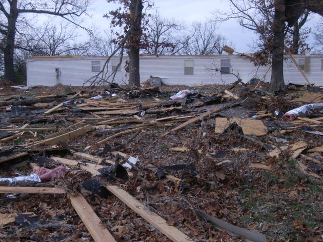 the-rooftop-remains-of-a-duplex-west-of-viola-are-shown-scattered-throughout-a-field-and-in-the-trees-after-strong-winds-and-a-possible-tornado-tore-through-the-area-sunday-afternoon