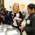 Heather Hart, center, a Grimes Elementary School teacher, welcomes Veronica dela Rosa, right, to the...