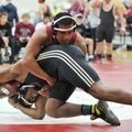 Calvin Bloomingburg (bottom) of Little Rock Central and Springdale's Johnny Lemari during their matc...