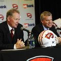 New Western Kentucky head coach Bobby Petrino, left, speaks with athletic director Todd Stewart duri...