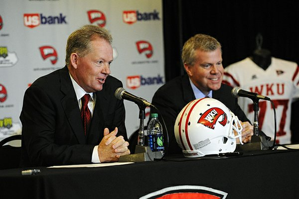 "New Western Kentucky head coach Bobby Petrino, left, speaks with athletic director Todd Stewart during an NCAA college football news conference, Monday, Dec. 10, 2012, in Bowling Green, Ky. The 51-year-old was fired by Arkansas in April for a ""pattern of misleading"" behavior following an accident in which the coach was injured while riding a motorcycle with his mistress as a passenger but now wants to make the most of his second chance. (AP Photo/The Daily News, Joe Imel)"