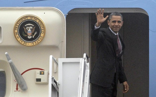 president-barack-obama-waves-as-he-boards-air-force-one-at-andrews-air-force-base-md-on-monday-dec-10-2012-before-departing-for-michigan