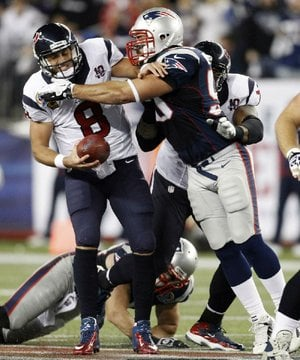 Houston Texans quarterback Matt Schaub is sacked by New England Patriots defensive end Rob Ninkovich on Monday.