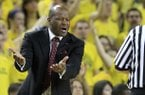 Arkansas head coach Mike Anderson argues a call during the first half of an NCAA college basketball game against Michigan in Ann Arbor, Mich., Saturday, Dec. 8, 2012. (AP Photo/Carlos Osorio)
