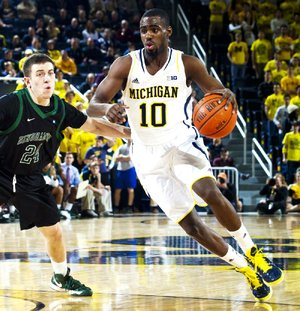 Michigan guard Tim Hardaway Jr. (right) drives against Binghamton guard Mike Horn on Tuesday in the second half of the No. 3 Wolverines' 67-39 victory in Ann Arbor, Mich.