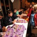 Courtney Berry, 14, right, has a souvenir poster signed by Brice Gahagans, left, and Austin Allen, F...
