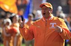 Tennessee offensive coordinator Jim Chaney, serving as interim head coach since Derek Dooley was fired after the last game, cheers for the senior class players as they take the field to play Kentucky in an NCAA college football game, Saturday, Nov. 24, 2012, in Knoxville, Tenn. The Vols won 37-17. The Vols won 37-17. (AP Photo/Chattanooga Times Free Press, Dan Henry)