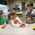Macenzee Breese, left, Graysen Ross and Garett Hilton choose their crayons for their Christmas tree ...