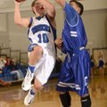 Rogers' Keifer Holt, left, takes the ball to the basket under pressure from Conway's Dominic Taylor ...