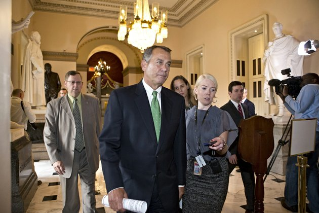 house-speaker-john-boehner-of-ohio-walks-to-the-house-floor-to-deliver-remarks-about-negotiations-with-president-barack-obama-on-the-fiscal-cliff-on-tuesday-dec-11-2012-on-capitol-hill-in-washington