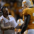 Sam Pittman talks with Tennessee offensive lineman Zach Fulton during a game against Akron at Neylan...