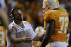 Sam Pittman talks with Tennessee offensive lineman Zach Fulton during a game against Akron at Neyland Stadium.