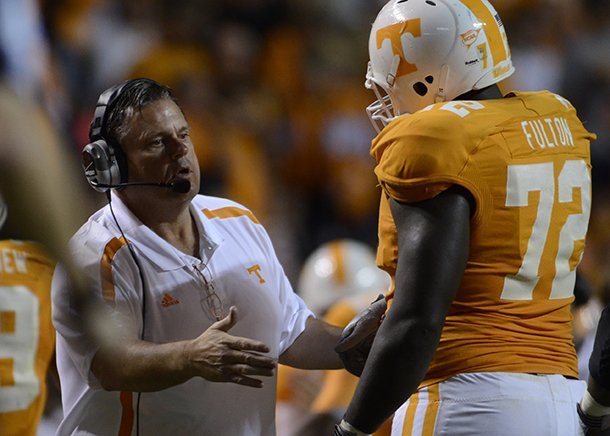 sam-pittman-talks-with-tennessee-offensive-lineman-zach-fulton-during-a-game-against-akron-at-neyland-stadium
