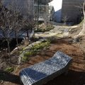 Chaise Gabion, a stainless steel and stones sculpture created in 2009 by Celeste Roberge, is located...