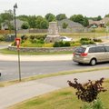 Drivers circle the one-lane roundabout May 25 at the intersection of John DeShields Boulevard and Mo...