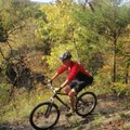 Tim Scott, assistant superintendent at Devil's Den State Park pedals in October along the Fossil Fla...