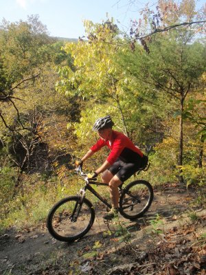 Tim Scott, assistant superintendent at Devil's Den State Park pedals in October along the Fossil Flats Trail. Parts of the trail have been rerouted for easier riding. The project added about one-half mile to the trail.
