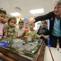 Sherrie Eoff, right, youth gardening chairman with the Garden Club of Rogers, demonstrates the effec...