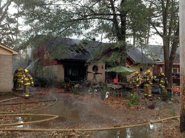 firefighters-work-at-8715-verbena-drive-where-a-blaze-significantly-damaged-the-home