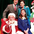 "Fred Mackaman, front left, performs as Kris Kringle in ""Miracle on 34th Street"" Saturday at Alma Per..."