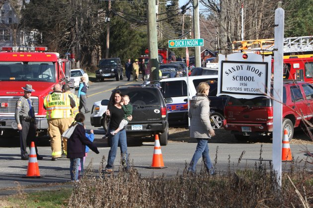 parents-walk-away-from-the-sandy-hook-elementary-school-with-their-children-following-a-shooting-friday-dec-14-2012-in-newtown-conn