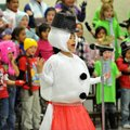 Madelyn Smith, a first-grader dressed as a snowman, sings with her classmates during their presentat...