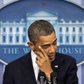President Barack Obama wipes his eye as he talks about the Connecticut elementary school shooting, F...
