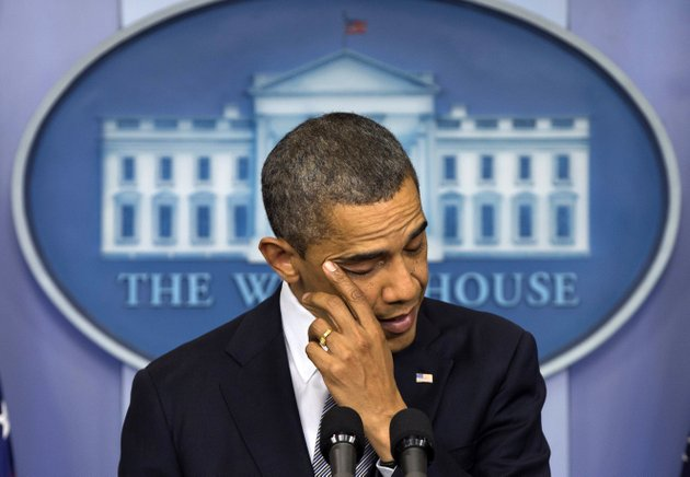 president-barack-obama-wipes-his-eye-as-he-talks-about-the-connecticut-elementary-school-shooting-friday-dec-14-2012-in-the-white-house-briefing-room-in-washington