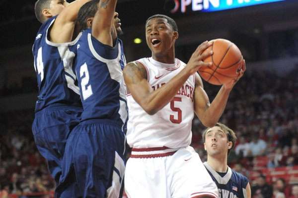 NWA Media/ANDY SHUPE -- Arkansas freshman guard Anthlon Bell (5) against Longwood on Sunday, Nov. 18, 2012, during the first half of play in Bud Walton Arena.