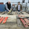 James Miles of Neosho, Mo., measure brush hog blades as his wife, Lahoma, and Bobby Luttrell of Faye...