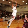 Dashaun Stark, a Springdale senior, dunks the ball as Benton center Josh Bowling trails the play dur...