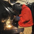 Fayetteville High student Joseph Davis makes a weld Wednesday as he and other students demonstrate t...