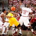 Arkansas freshman Dee Wagner (left) and junior Fred Gulley (right) force a turnover by Alcorn State ...