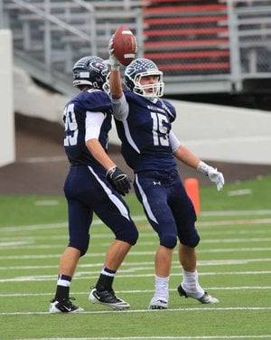 Drew Morgan (right) helped lead Greenwood to a third consecutive state championship while accounting for more than 2,000 all-purpose yards and 27 touchdowns.