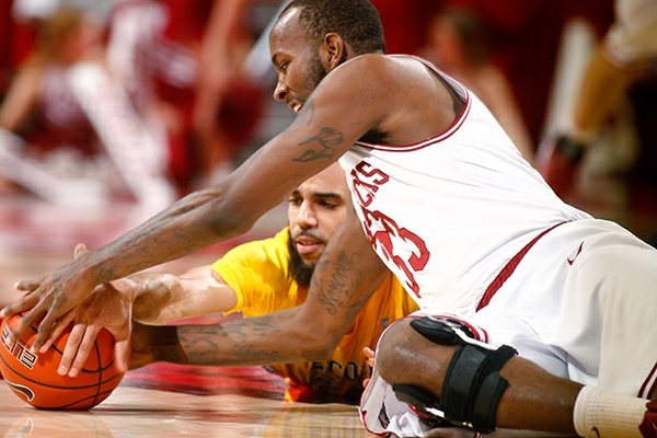NWA Media/JASON IVESTER -- Arkansas junior Marshawn Powell and Alcorn State senior Ian Francis go after a loose ball on the floor during the first half on Saturday, Dec. 15, 2012, at Bud Walton Arena in Fayetteville.