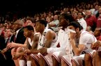Arkansas' bench looks on during a win over Oklahoma on Dec. 4.
