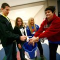 Joe Adams, from left, Kelsey Thomas and Kennedy Cottrell, all seniors and Deca members, hold out a b...