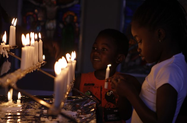 worshippers-light-candles-and-dedicate-prayers-at-the-rosebank-catholic-church-in-johannesburg-sunday-dec-16-2012-south-africas-former-president-nelson-mandela-underwent-a-successful-surgery-to-remove-gallstones-saturday-the-nations-presidency-said-as-the-94-year-old-anti-apartheid-icon-is-still-recovering-from-a-lung-infection-doctors-treating-mandela-waited-to-perform-the-endoscopic-surgery-as-they-wanted-to-first-attend-to-his-lung-ailment-presidential-spokesman-mac-maharaj-said-in-a-statement-mandela-has-been-hospitalized-since-dec-8