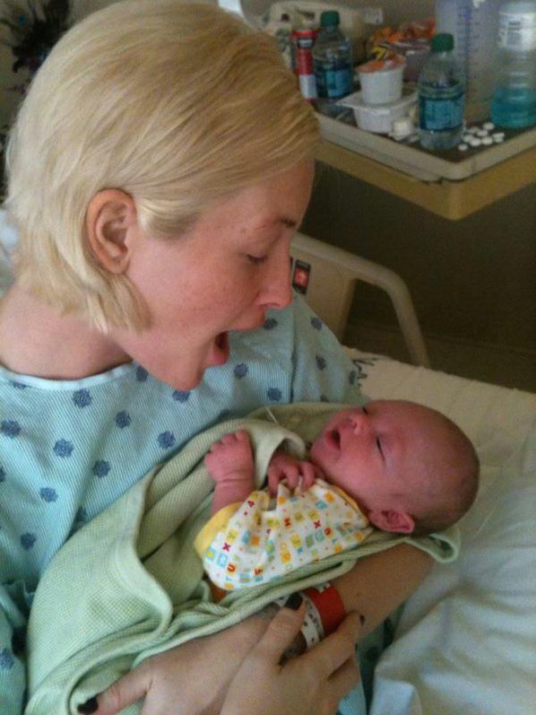 Leslie Harris cradles her newborn ...