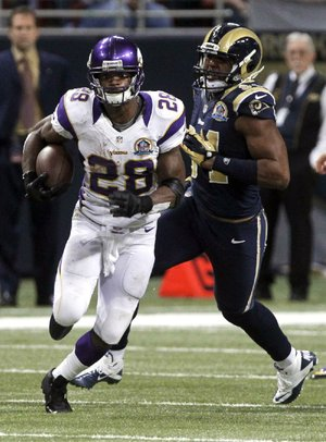 Minnesota Vikings running back Adrian Peterson (left) had a season high 212 yards on 24 carries against the St. Louis Rams on Sunday. Peterson has 1,812 yards rushing, leaving him 294 shy of breaking the NFL's single-season mark of 2,105 set by Eric Dickerson in 1984.