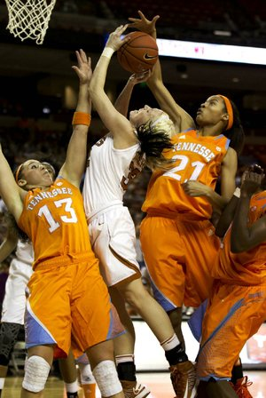 Texas' Brady Sanders (middle) tries to squeeze between Tennessee's Taber Spani (left) and Nia Moore (right) in the Lady Vols' 94-75 victory Sunday.
