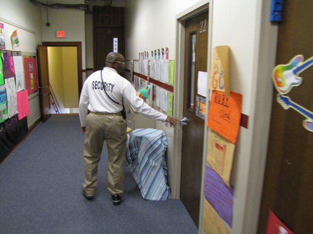 christopher-sims-a-security-officer-at-pulaski-heights-elementary-school-checks-doors-during-a-round-monday-afternoon
