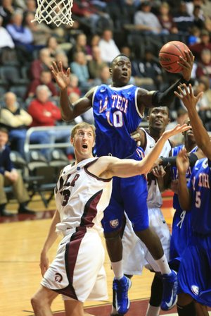 Louisiana Tech forward Isaiah Massey (10) pulls down a rebound over UALR forward Will Neighbour (53) during Monday's game at the Jack Stephens Center in Little Rock. Neighbour finished with 7 points, 5 rebounds and 1 block as the Trojans lost 75-73.